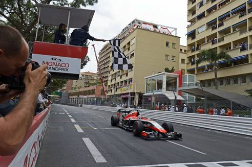 Jules Bianchi crosses the line to score Marussia's first points. Marussia F1 Team