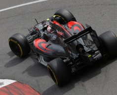Button pleased to collect first McLaren points