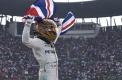 Hamilton takes fourth title despite collision