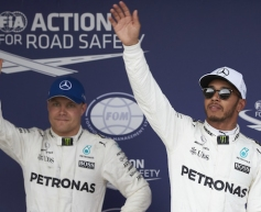 Hamilton sets new lap record with pole time
