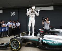 Hamilton flies to British Grand Prix pole